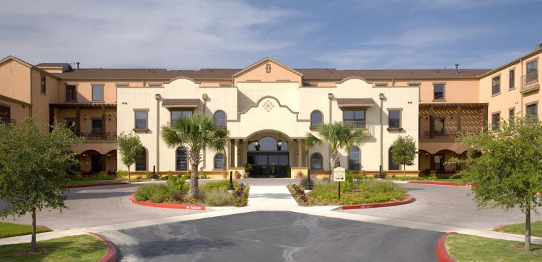 An architectural photo of the exterior of a senior living facility.